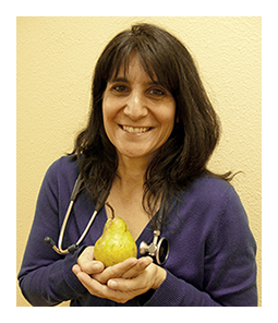 Dr. Kutob holding a pear